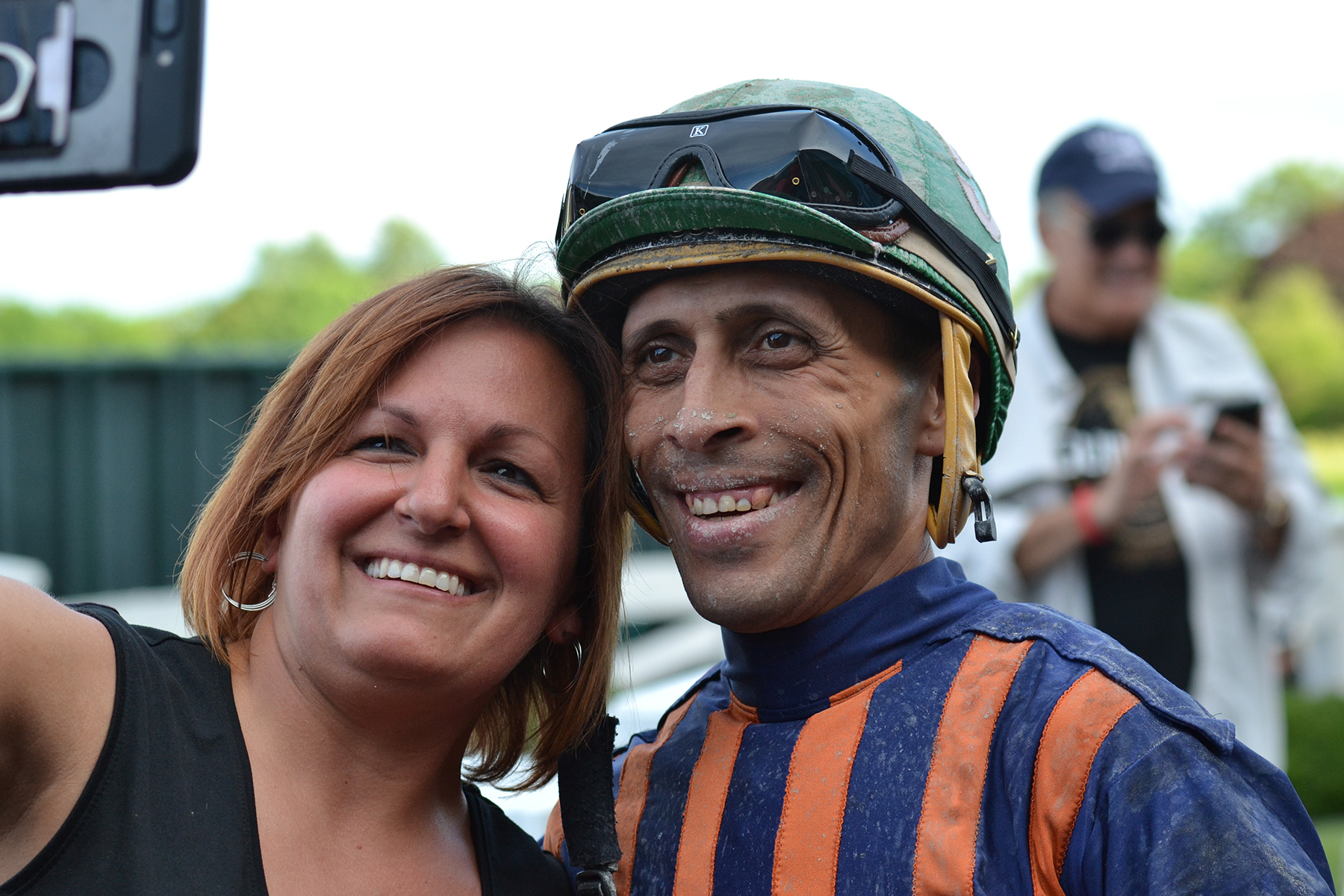 Andy Hernandez Sanchez takes selfies with well-wishers after he wins the last race at Suffolk Downs