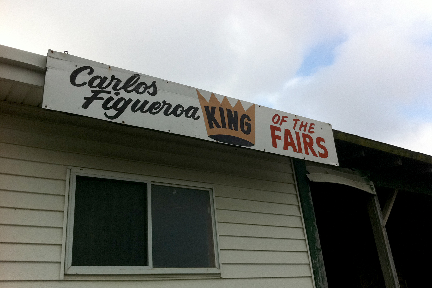 Carlos Figueroa's King of the Fairs sign on his Suffolk Downs barn