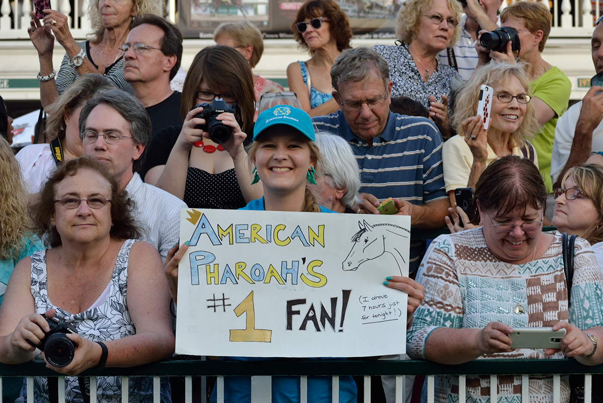 Fans line the paddock fence for American Pharoah