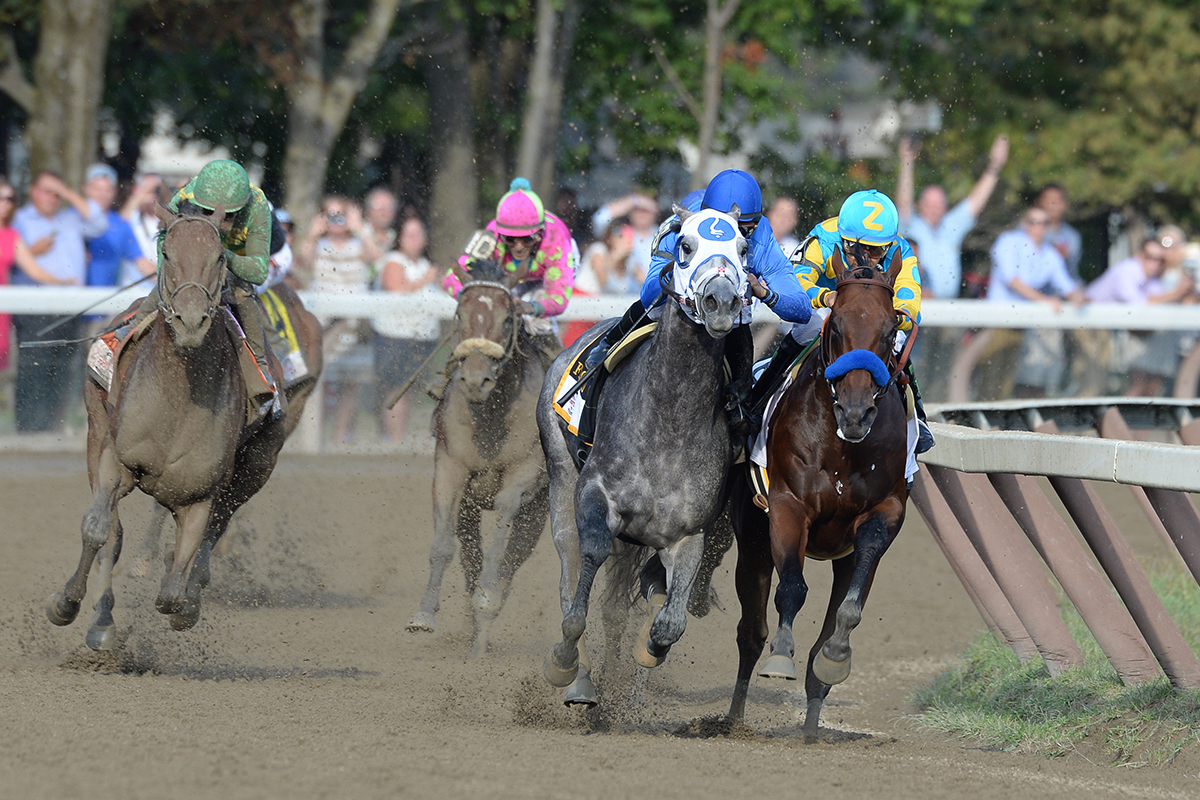 American Pharoah and Frosted go head to head around the stretch turn of the 2015 Travers Stakes at Saratoga