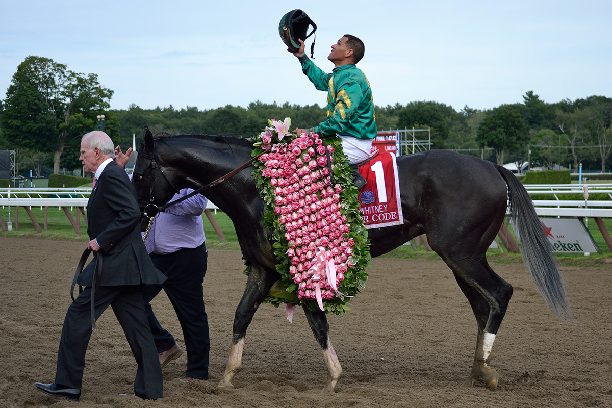 Jockey Javier Castellano gives thanks for the winning the 2015 Whitney with Honor Code