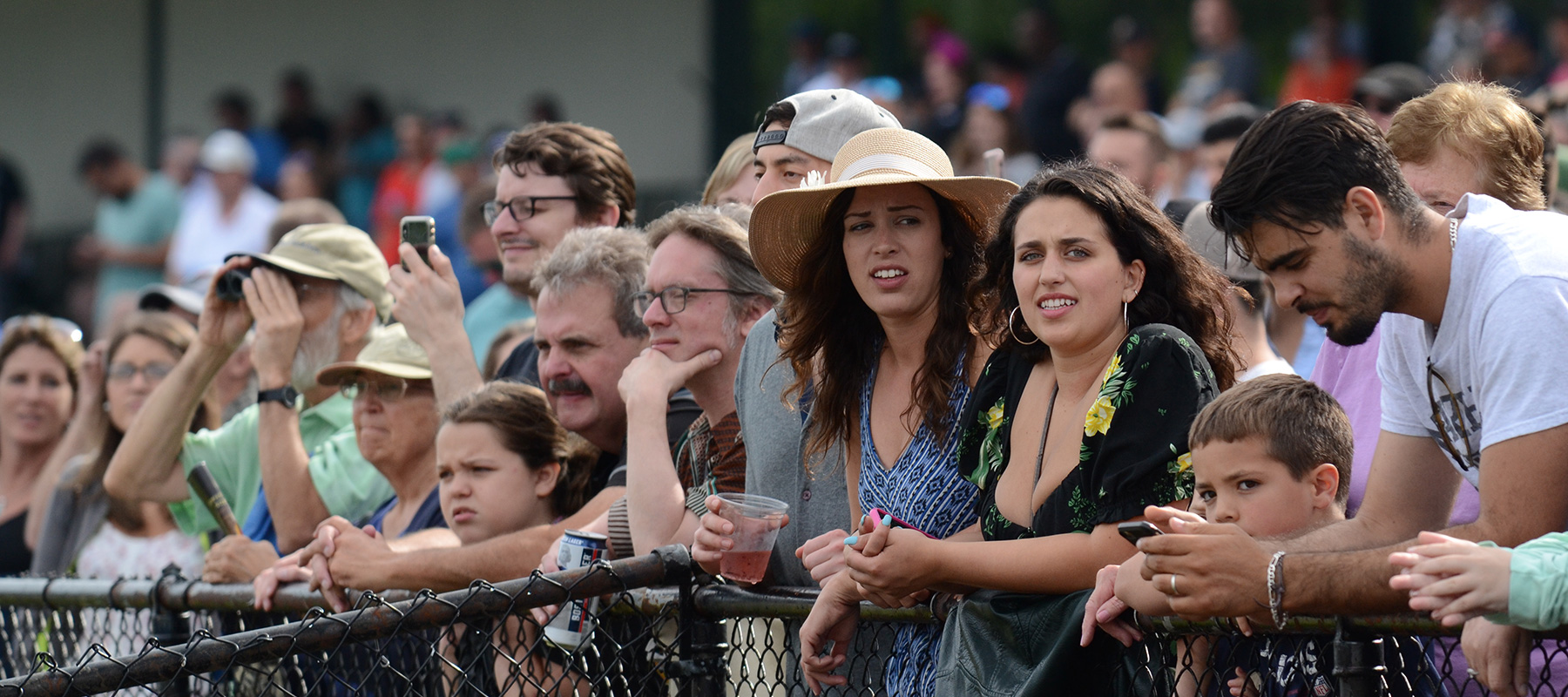 The crowd along the clubhouse rail at Suffolk Downs